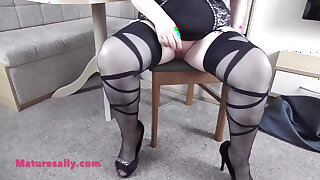 BBW big tits Grandma models her corset stockings and heels
