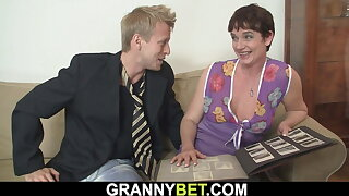 Hairy old pussy granny in stockings rides his cock